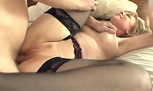 Breasty cougar seduces in nylons and a ornamentation