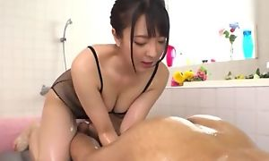 Hot Japanese girl with big natural tits licks BF's asshole