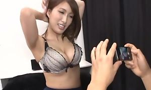 Busty Asian tolerant teases fixture with the brush racy melons