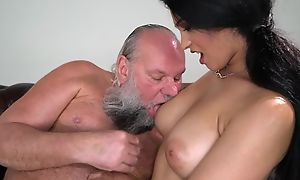 Interesting brunette with big naturals fucks an venerable man