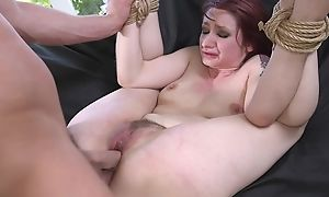 Redhead sub obtaining spanked, throat fucked and sodomized